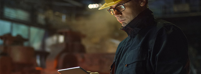 construction-worker-viewing-tablet-in-work-environment