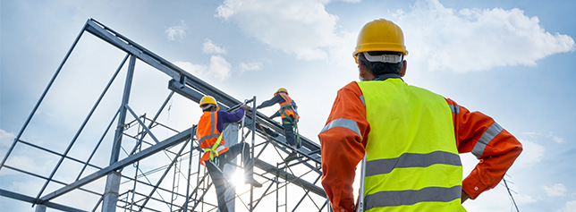 construction-workers-climbing-building