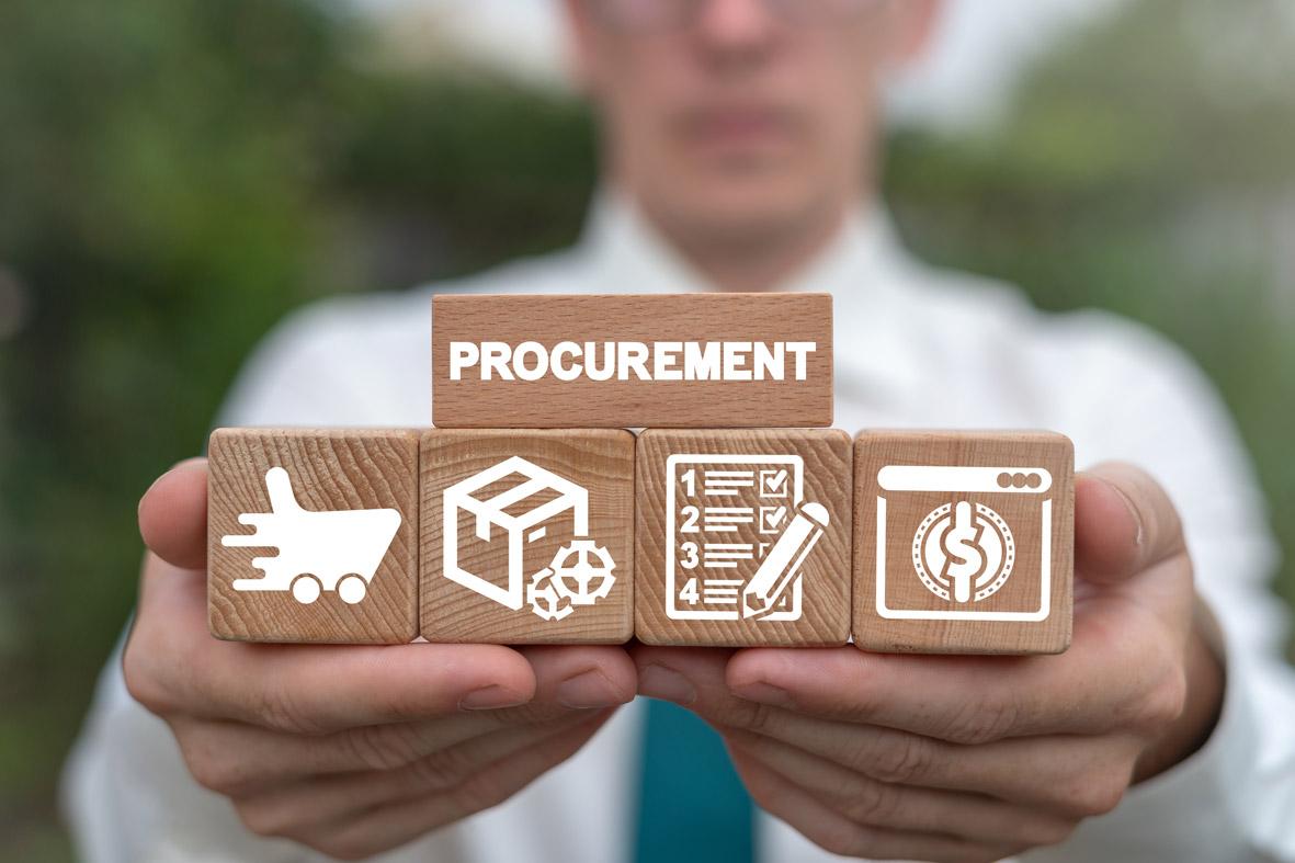 man holding blocks showing the procurement process