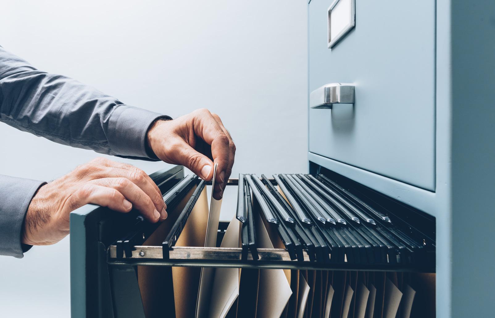 worker filing paperwork